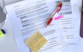 Photographie d'un document de présentation du projet, annoté.